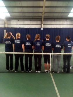 Kent Tennis players in line on an indoor court