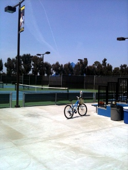 Tennis court with bicycle