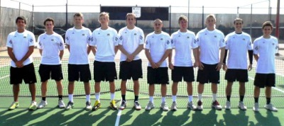 Male tennis players in a line in front of a net